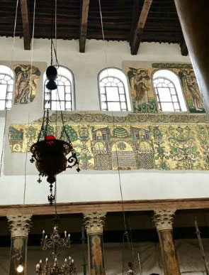 Part of restored mosaic and hanging oil lamps